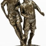 two soccer players, football players, men, bronze, trophy
